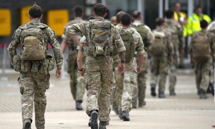 A member of the British armed forces 16 Air Assault Brigade who returned from helping in operations to evacuate people from Kabul airport in Afghanistan walk to the air terminal after disembarking a RAF Voyager aircraft at RAF Brize Norton, Oxfordshire, England, on Aug. 28, 2021. (Alastair Grant/PA)