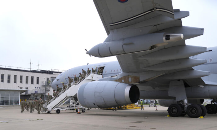 Members of the British armed forces 16 Air Assault Brigade who returned from helping in operations to evacuate people from Kabul airport in Afghanistan disembark a RAF Voyager aircraft after landing at RAF Brize Norton, Oxfordshire, England, on Aug. 28, 2021. (Alastair Grant/PA)