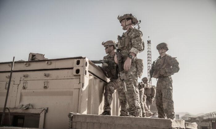 U.S. service members assist at an Evacuation Control Check Point (ECC) during an evacuation at Hamid Karzai International Airport, Kabul, Afghanistan, on Aug. 26, 2021. (Staff Sgt. Victor Mancilla/U.S. Marine Corps/Handout via Reuters)
