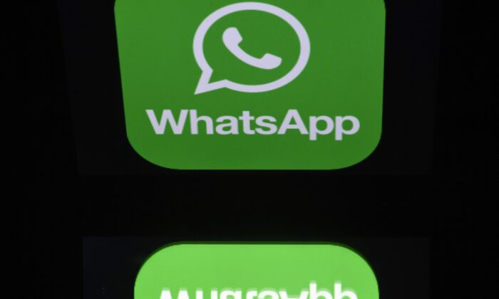 A picture taken in Paris shows the logo of WhatsApp mobile messaging service, on Dec. 28, 2016. (Lionel Bonaventure/AFP via Getty Images)