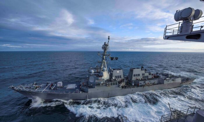 The U.S. Navy Arleigh Burke-class guided missile destroyer USS Kidd transits alongside the aircraft carrier USS Theodore Roosevelt while participating in Exercise Northern Edge 2019 in the Gulf of Alaska, on May 16, 2019. (U.S. Navy/Mass Communication Specialist 3rd Class Sean Lynch/File Photo/Handout via Reuters)