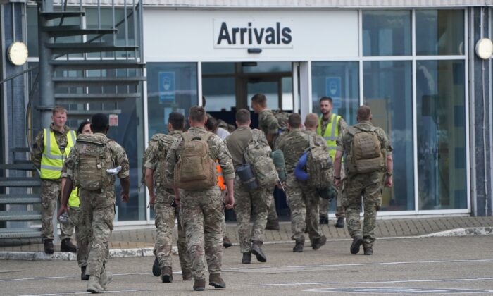 Members of the British armed forces 16 Air Assault Brigade walk to the air terminal after departing a flight from Afghanistan at RAF Brize Norton, in Oxfordshire, UK, on Aug. 29, 2021. (Jonathan Brady/PA)
