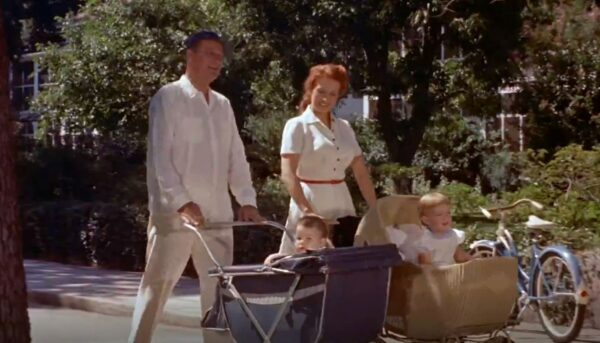 mom and dad with babes in strollers