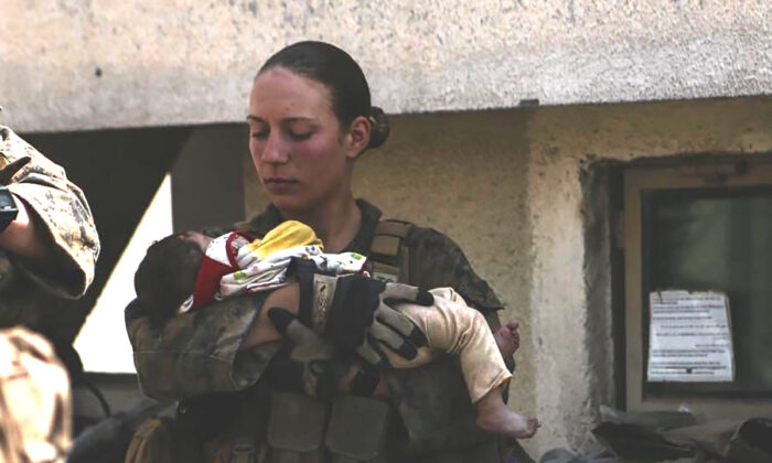 Sgt. Nicole Gee holding a baby at Hamid Karzai International Airport in Kabul, Afghanistan in an undated photo. (U.S. Department of Defense via AP)