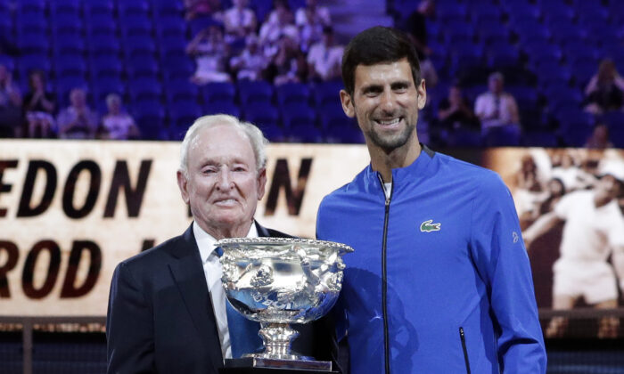 Serbia's Novak Djokovic (R), presents a trophy to Rod Laver during the 50th anniversary celebration for the Australian Open and Laver's second Grand Slam at the Australian Open tennis championships in Melbourne, Australia on Jan. 14, 2019. (Aaron Favila/AP Photo)