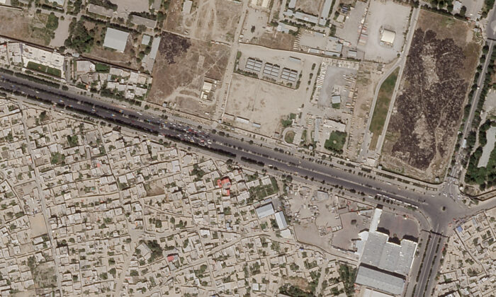 In this satellite photo taken by Planet Labs Inc., a Taliban checkpoint is seen blocking access just south of Kabul's international airport, in Afghanistan, on Aug. 28, 2021. (Planet Labs Inc. via AP)