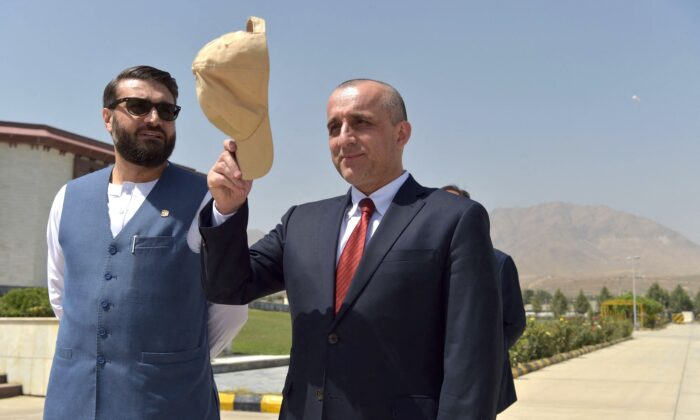 Then-Vice President of Afghanistan Amrullah Saleh (R) gestures as he stands along with National Security Adviser of Afghanistan Hamdullah Mohib prior to a meeting at the Afghan Parliament house in Kabul on Aug. 2, 2021. (Wakil Kohsar/AFP via Getty Images)