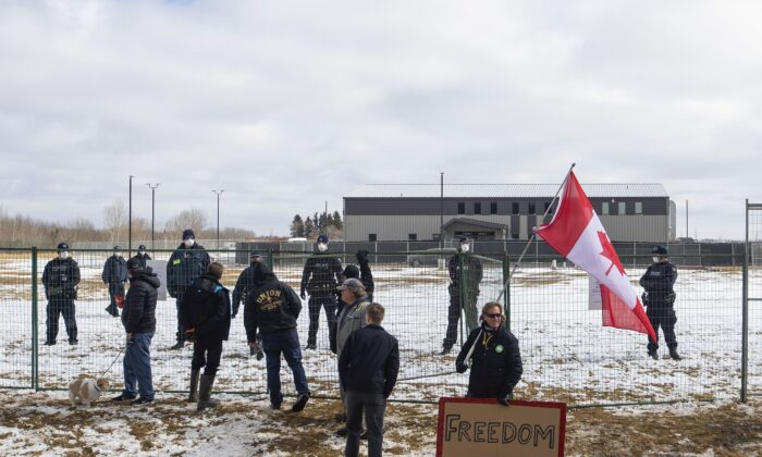 Supporters gather outside GraceLife Church near Edmonton on April 11, 2021, after the church was fenced off by police and Alberta Health Services for violating COVID-19 restrictions. (The Canadian Press/Jason Franson)