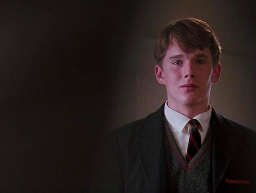 school boy in suit jacket and tie in Dead Poets Society