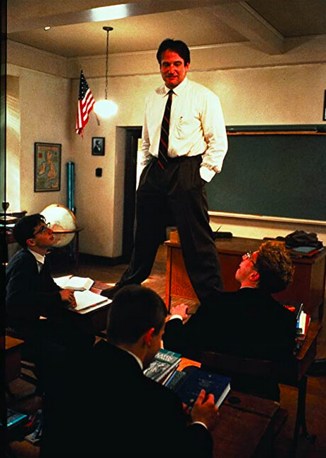 Man stands on desk in Dead Poets Society