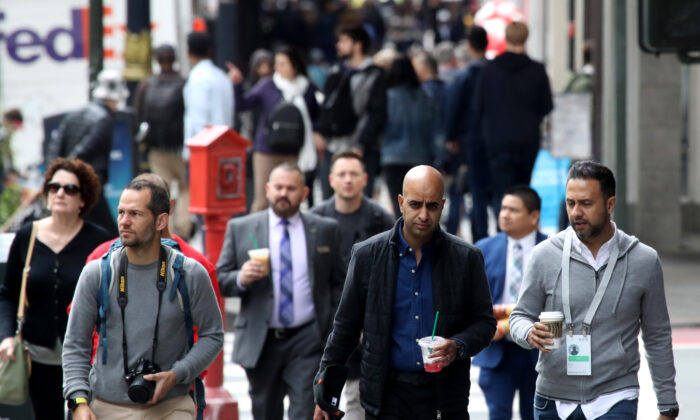 Pedestrians walk along Powell Street in San Francisco on May 14, 2019. (Justin Sullivan/Getty Images)