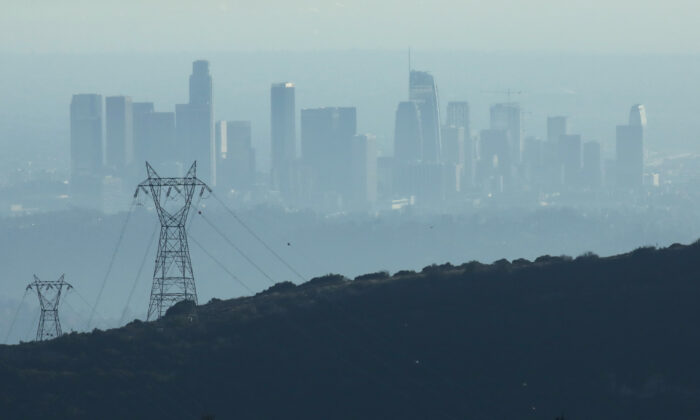 The buildings of downtown Los Angeles, as seen from Pasadena, Calif., are partially obscured in the late afternoon by smog on Nov. 5, 2019. (Mario Tama/Getty Images)