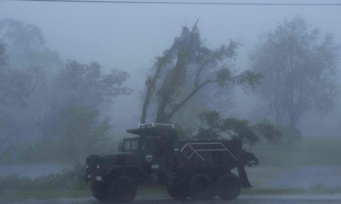 A truck is seen in heavy winds and rain from Hurricane Ida in Bourg, La., on Aug. 29, 2021. (Mark Felix/AFP via Getty Images)
