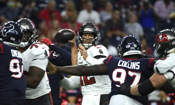 Tampa Bay Buccaneers quarterback Tom Brady (12) throws a pass against the Houston Texans during the first half of an NFL preseason football game in Houston, on Aug. 28, 2021. (Eric Christian Smith/AP Photo)