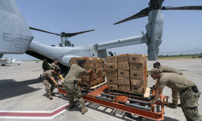 Food is loaded onto a VM-22 Osprey at Toussaint Louverture International Airport in Port-au-Prince, Haiti, on Aug. 28, 2021. (Alex Brandon/AP Photo)