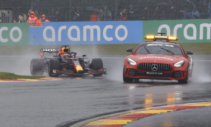 Red Bull driver Max Verstappen of the Netherlands follows behind the safety car for the formation lap during the Formula One Grand Prix at the Spa-Francorchamps racetrack in Spa, Belgium, on Aug. 29, 2021. (Olivier Matthys/AP Photo)