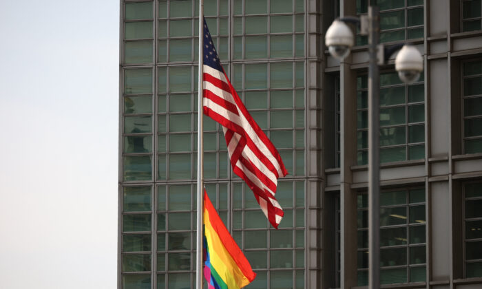 The rainbow flag is hanging next to the U.S. national flag over the entrance to the the U.S. Embassy in Moscow on June 25, 2021. (Dimitar Dilkoff/AFP via Getty Images)