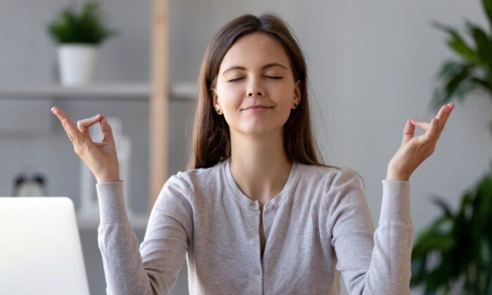 A woman meditating in stock photo. (Depositphotos.com)