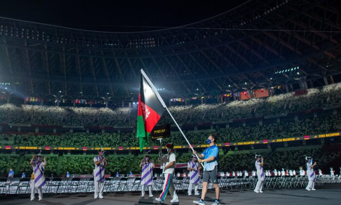 Afghanistan's flag was paraded at the Tokyo Paralympics opening ceremony on Tuesday, August 24, 2021. (AAP Image/OIS/IOC/Joel Marklund)