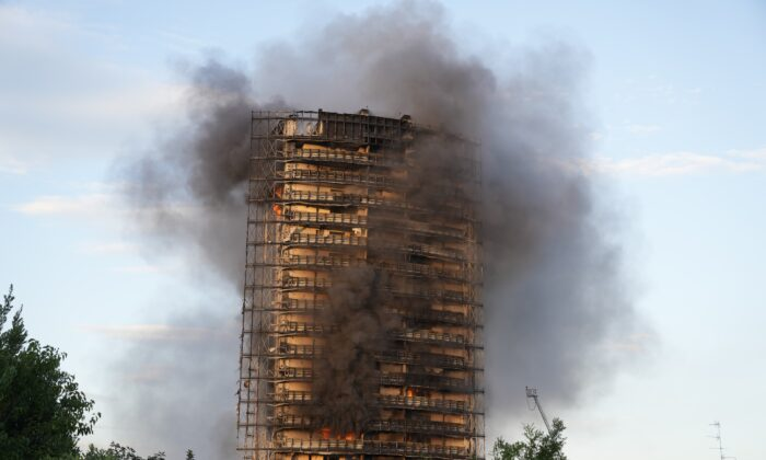 Smoke billows from a building in Milan, Italy, on Aug. 29, 2021. (Luca Bruno/AP Photo)