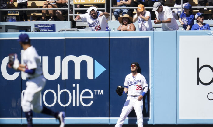 Los Angeles Dodgers center fielder Cody Bellinger (35) reacts after catching a line drive hit by Colorado Rockies' Connor Joe during the sixth inning of a baseball game in Los Angeles on Aug. 29, 2021. (AP Photo/Ashley Landis)