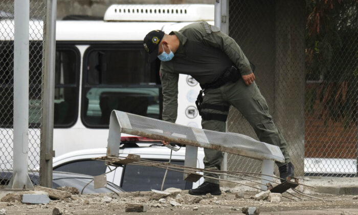 A police officer inspects damage at a police station after a bomb exploded in Cucuta, Colombia, near the Venezuelan border, on Aug. 30, 2021. (Ferley Ospina/AP Photo)