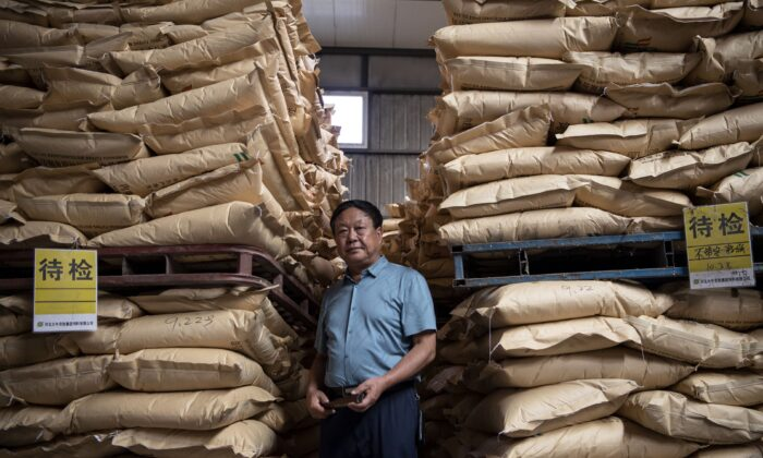 Chinese pig farmer Sun Dawu posing at a feed warehouse in Hebei, outside Beijing, on Sept. 24, 2019. (Noel Celis/AFP via Getty Images)
