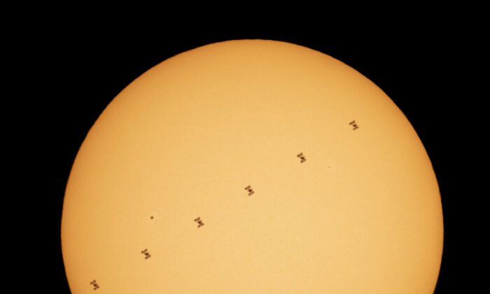 In this NASA handout, This composite image made from six frames shows the International Space Station, with a crew of seven aboard, is seen in silhouette as it transits the sun at roughly five miles per second on Friday, April 23, 2021, as seen from Nottingham, Maryland. (Credit: Bill Ingalls/NASA via Getty Images)