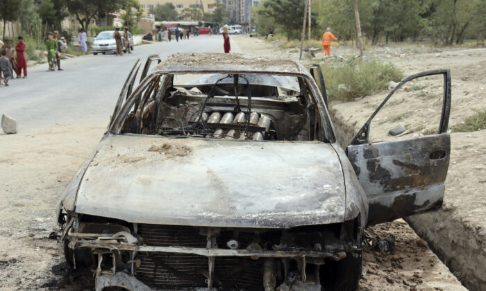 Rocket launcher tubes are seen in a destroyed vehicle vehicle in Kabul, Afghanistan, on Aug. 30, 2021. (Khwaja Tawfiq Sediqi/AP Photo)