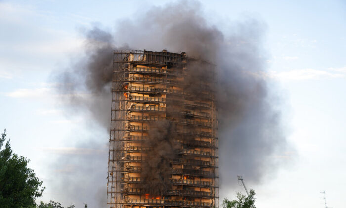 Smoke billows from a 16-story residential building in Milan, Italy, on Sunday, Aug. 29, 2021. (Luca Bruno/AP Photo)
