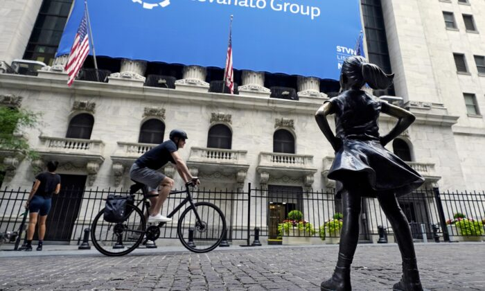 The Fearless Girl statue faces the New York Stock Exchange in New York on July 20, 2021. (Richard Drew/AP Photo)