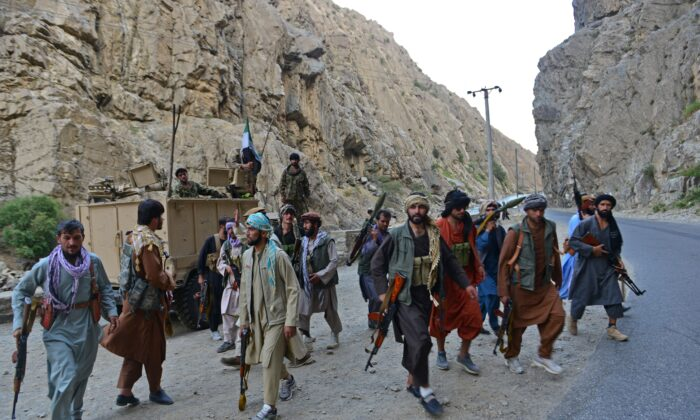 Afghan resistance movement and anti-Taliban uprising forces personnel patrol along a road in Rah-e Tang of Panjshir province on Aug. 29, 2021. (Ahmad Sahel Arman/AFP via Getty Images)