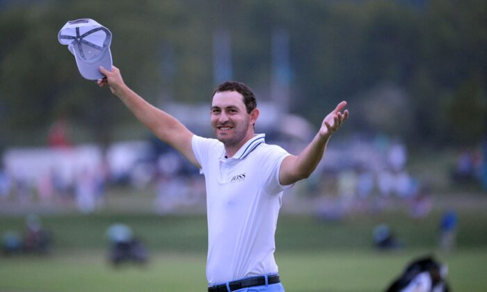 Patrick Cantlay reacts after sinking in his putt on the 18th green, the sixth playoff hole of the final round of the BMW Championship golf tournament, at Caves Valley Golf Club in Owings Mills, Md., on Aug. 29, 2021. (Nick Wass/AP Photo)