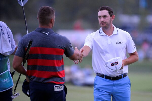 Patrick Cantlay (R) shakes hands with Bryson DeChambeau