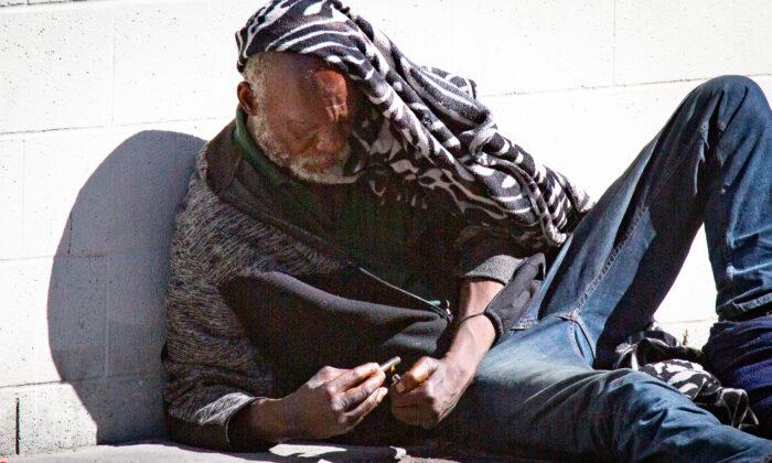 A man used drugs in Los Angeles, Calif., on June 9, 2021. (John Fredricks/The Epoch Times)