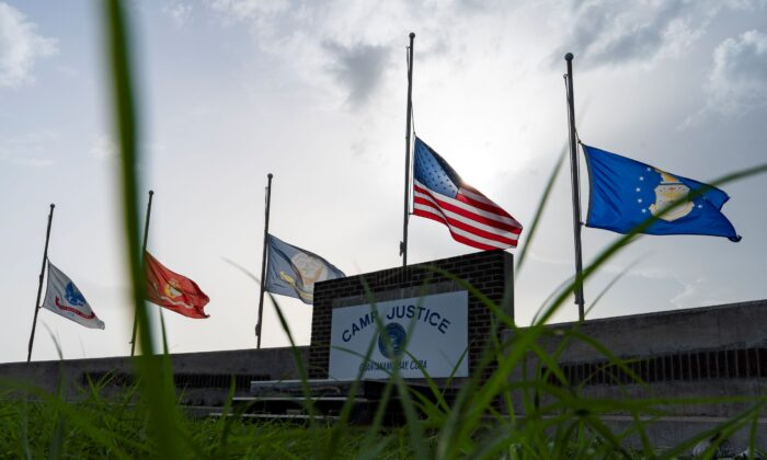 Flags fly at half-staff in honor of the U.S. service members and other victims killed in the terrorist attack in Kabul, Afghanistan, at Camp Justice, in Guantanamo Bay Naval Base, Cuba, on Aug. 29, 2021. (Alex Brandon/AP Photo)