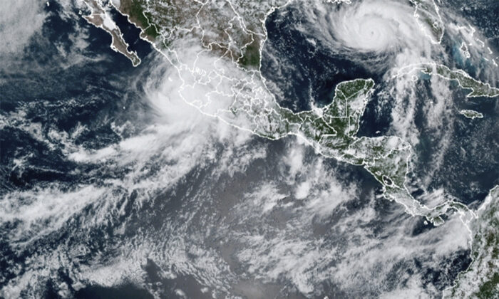 Hurricane Nora (upper left) and Hurricane Ida, (upper right) over the North American continent on Aug. 28, 2021. (NOAA via AP)