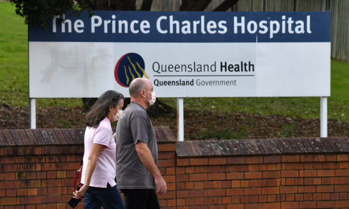 People wearing protective face mask are seen at the entry to Prince Charles Hospital in Brisbane, Australia on June 30, 2021. (AAP Image/Darren England)