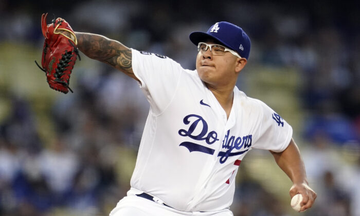 Los Angeles Dodgers starting pitcher Julio Urias throws during the first inning of a baseball game against the Atlanta Braves in Los Angeles on Aug. 30, 2021. (AP Photo/Marcio Jose Sanchez)