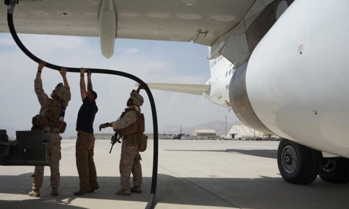 U.S. Forces, under the command of Maj. Gen. Chris Donahue, Commander 82d Airborne, refuel the Ark Salus Private Air Carrier Afghan Rescue Boeing 737 on its maiden voyage at Hamid Karzai International Airport on Aug. 22, 2021. (Ark Salus)