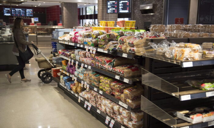 Various brands of bread sit on shelves in a grocery store in Toronto in a file photo. (The Canadian Press/Doug Ives)