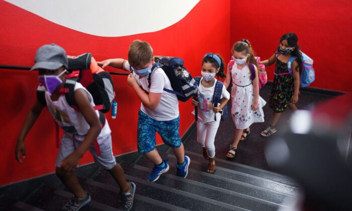 Students with face masks go upstairs to their classrooms at the Petri primary school in Dortmund, western Germany, on Aug. 12, 2020. (Ina Fassbender/AFP via Getty Images)