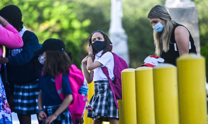 A student wears a facemask as she enters the St. Lawrence Catholic School on the first day of school after summer vacation in north of Miami, on Aug. 18, 2021. (Chandan Khanna/AFP via Getty Images)