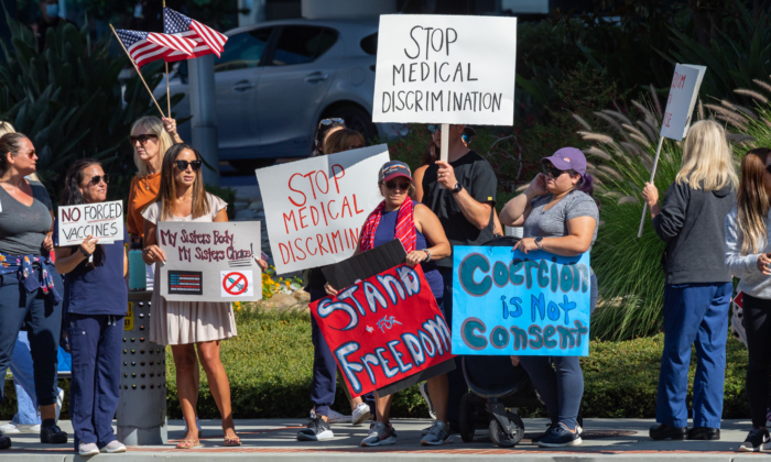 Medical personnel protest manditory vaccines in Orange, Calif., on Aug. 9, 2021. (John Fredricks/The Epoch Times)