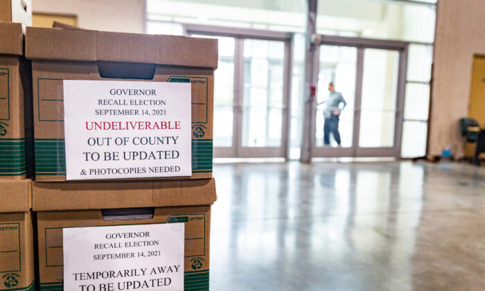 People count California recall ballot votes at a Los Angeles Registrar site at the Los Angeles Fair Grounds in Pomona, Calif., on Aug. 31, 2021. (John Fredricks/The Epoch Times)