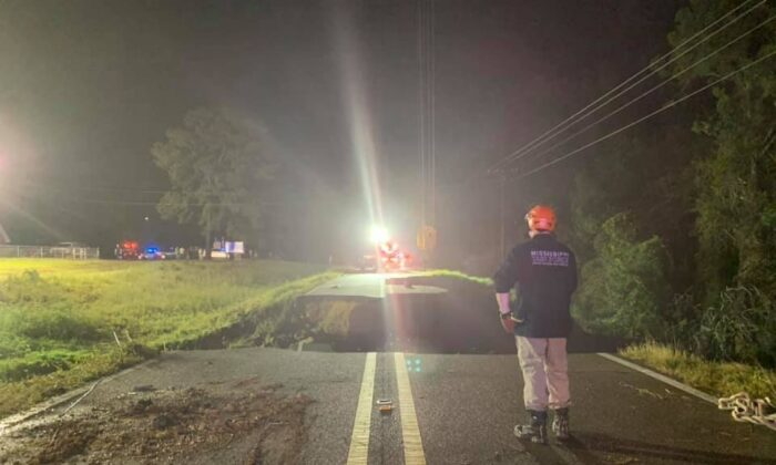 State troopers along with various other agencies at the scene of a road collapse on Highway 26 near Crossroads Road in George County, Miss., on Aug. 31, 2021. (Courtesy of Mississippi Highway Patrol)
