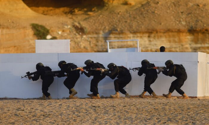 A Pakistan Special Service Group of naval commandos take part in the first day of the multinational naval exercise in Karachi on Feb. 11, 2017. (Rizwan Tabassum/AFP via Getty Images)