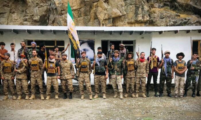 Men prepare for defense against the Taliban in Panjshir, Afghanistan, on Aug. 22, 2021. (Aamaj News Agency via Reuters)