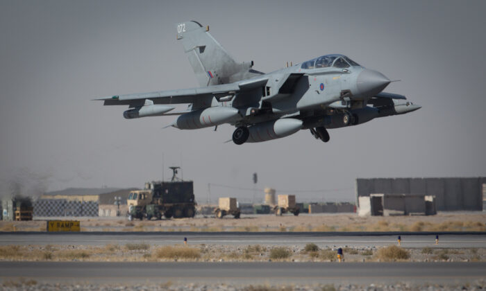 A Tornado from RAF Marham's 31 Squadron takes off from Kandahar airfield, completing the Squadron's final deployment to Afghanistan, on Nov. 11, 2014. (Matt Cardy/Getty Images)