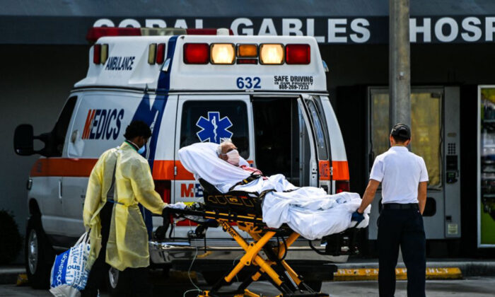 Medics transfer a patient on a stretcher from an ambulance outside of Emergency at Coral Gables Hospital where coronavirus patients are treated in Coral Gables near Miami, Fla., on Aug. 16, 2021. (Chandan Khanna/AFP via Getty Images)
